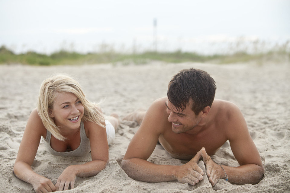 Julianne Hough and Josh Duhamel are shown in a scene from �Safe Haven.� AP PHOTO