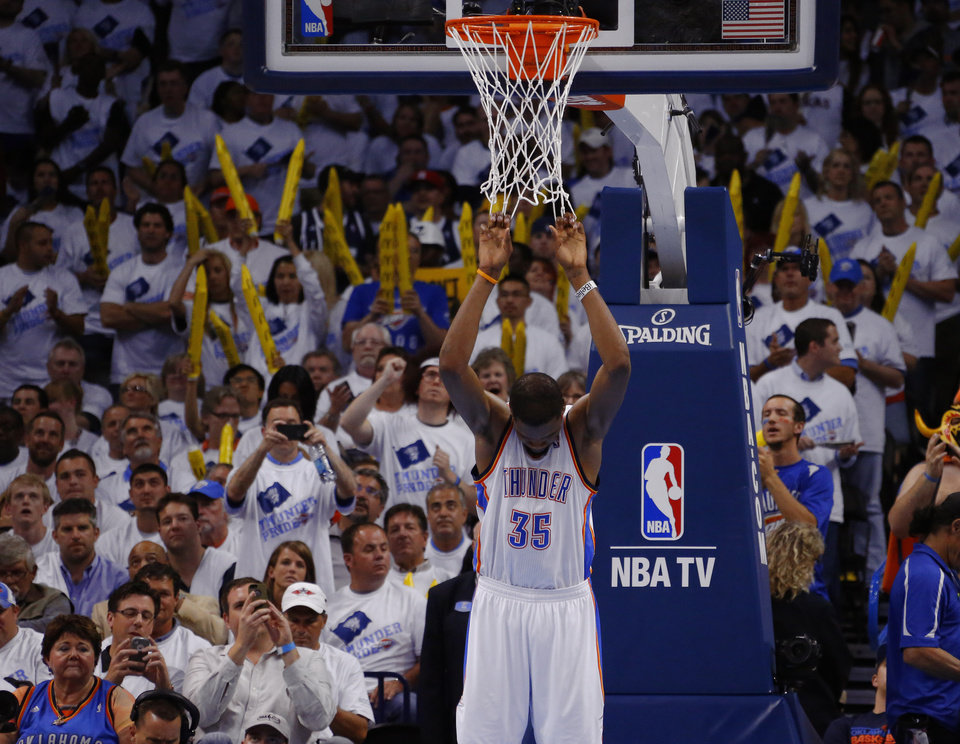 Photo - Oklahoma City's Kevin Durant (35) hangs on the net during a timeout in Game 5 in the second round of the NBA playoffs between the Oklahoma City Thunder and the Memphis Grizzlies at Chesapeake Energy Arena in Oklahoma City, Wednesday, May 15, 2013. Memphis won 88-84.  Photo by Bryan Terry, The Oklahoman
