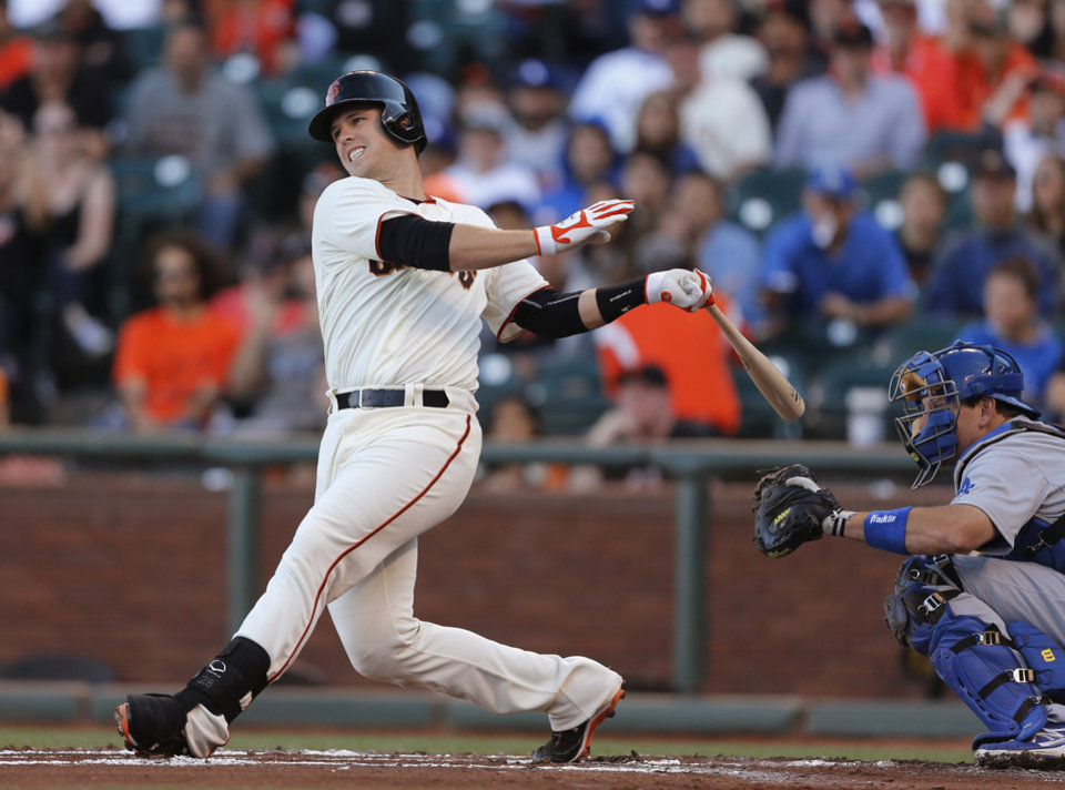 Photo - San Francisco Giants' Buster Posey hits into a double play during the first inning of a baseball game against the Los Angeles Dodgers, Saturday, July 26, 2014, in San Francisco. (AP Photo/Beck Diefenbach)