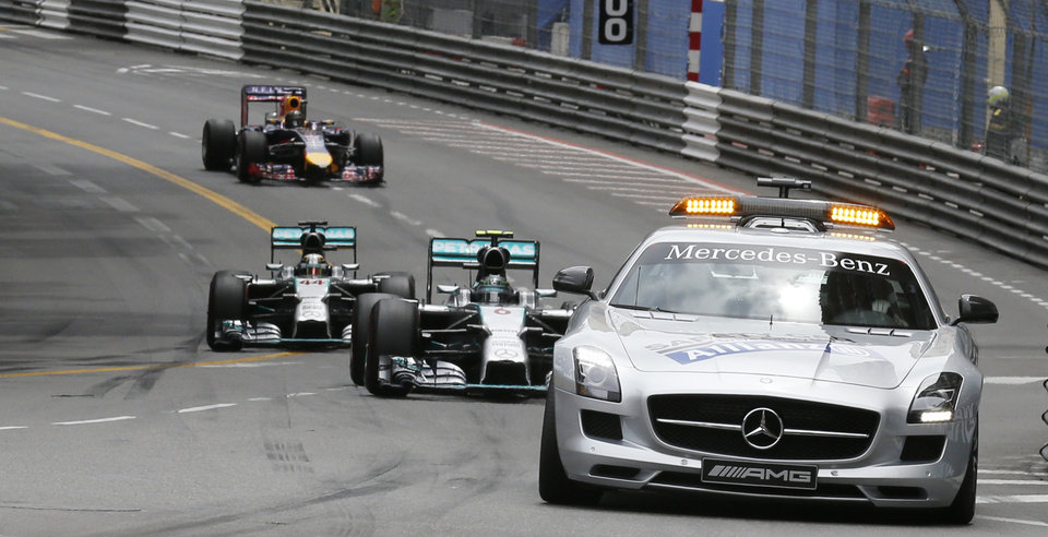 Photo - Mercedes driver Nico Rosberg of Germany, Mercedes driver Lewis Hamilton of Britain  and Red Bull driver Sebastian Vettel of Germany follow a safety car during the second lap of the Monaco Formula One Grand Prix, at the Monaco racetrack, in Monaco, Sunday, May 25, 2014. (AP Photo/Luca Bruno)