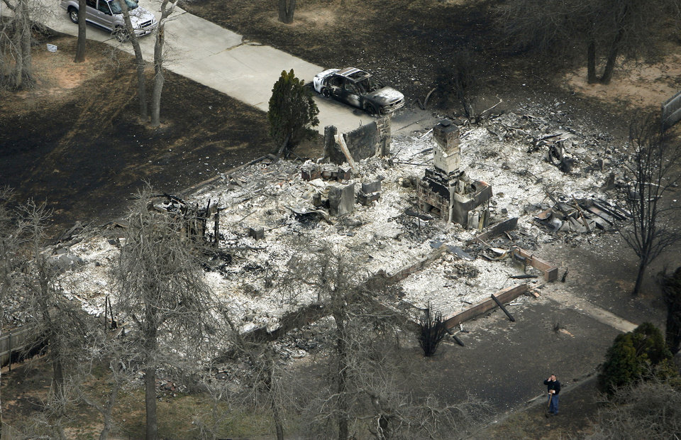 Photo - This is one of many houses reduced to ashes in Choctaw, OK, Friday, April 10, 2009. Photo by Paul Hellstern