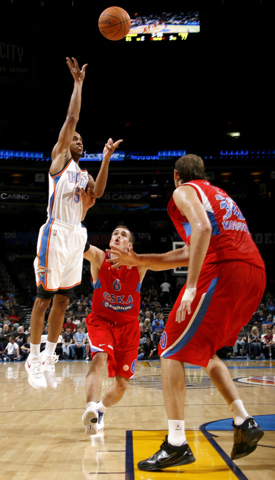 Oklahoma City's Eric Maynor (6) shoots in front of CSKA Moscow's Sergey  Bykov (6), center, and Dmitry Sokolov (30) during the preseason NBA basketball game between the Oklahoma City Thunder and CSKA Moscow in Oklahoma City, Thursday, October 14, 2010. Photo by Bryan Terry, The Oklahoman