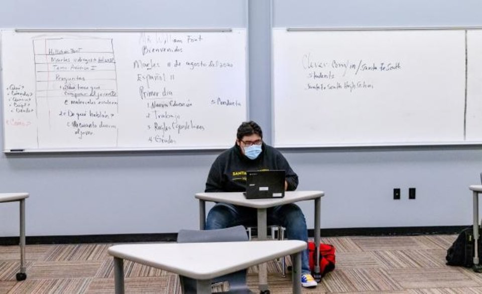 Photo -  A Santa Fe South High School student takes part in a Spanish class at the school in Oklahoma City on Wednesday. Santa Fe South Schools was among the first districts to reopen face-to-face in the Oklahoma City metro area for the 2020-21 school year. The charter school district had 25% of the students at each school return in person on Tuesday.  [Chris Landsberger/The Oklahoman]