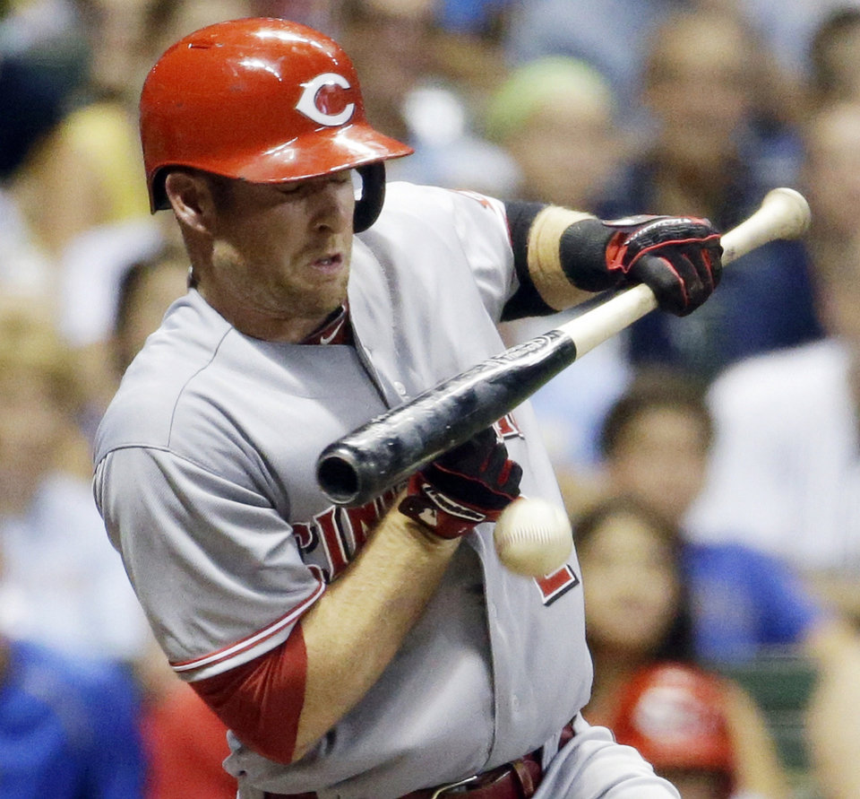 Photo - Cincinnati Reds' Zack Cozart is hit by a pitch during the seventh inning of a baseball game against the Milwaukee Brewers, Tuesday, July 22, 2014, in Milwaukee. (AP Photo/Morry Gash)