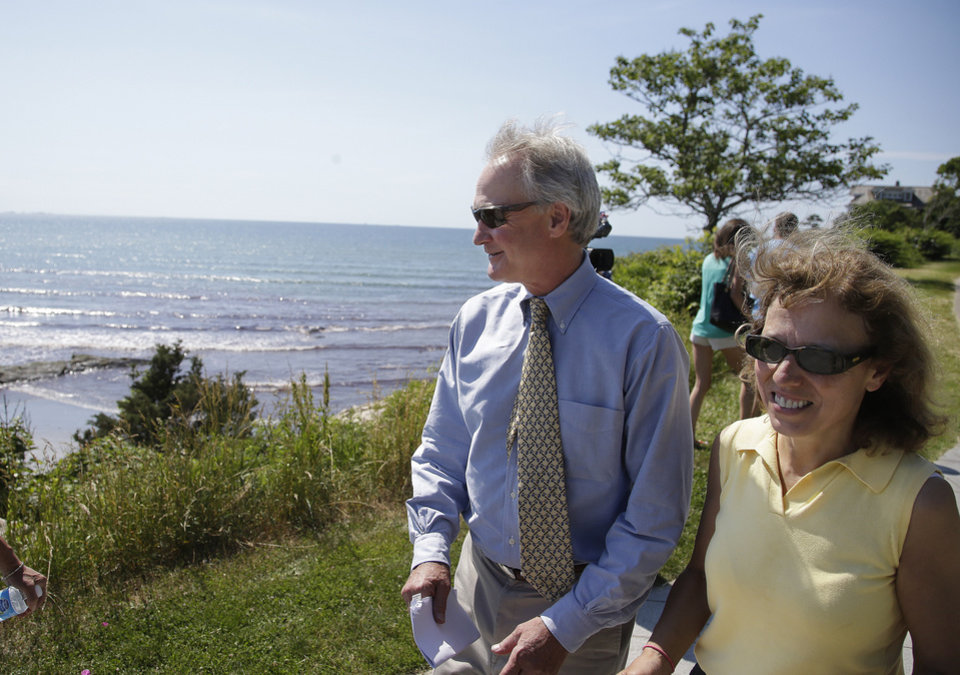 Photo - Rhode Island Gov. Lincoln Chafee, and state Senate President Teresa Paiva Weed walk along the Cliff Walk shortly before a ribbon cutting ceremony officially reopening the well known attraction Tuesday, June 24, 2014 in Newport, RI. Parts of the walk were damaged by Superstorm Sandy in 2012.   The storm washed away and damaged several sections of the walk, and most of it has been closed since the 2012 storm.  (AP Photo Stephan Savoia)