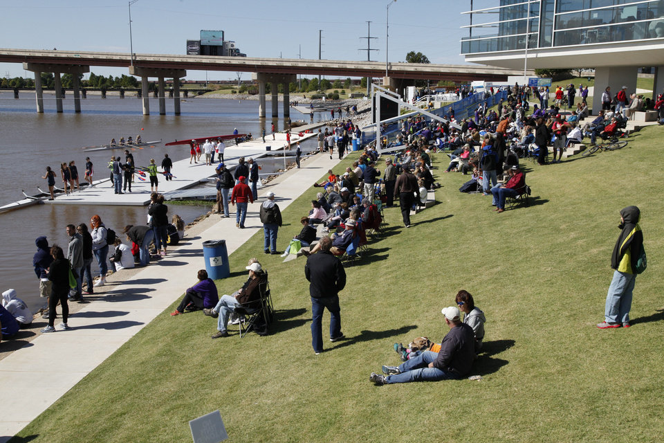 Photo - Spectators watch the Oklahoma Regatta Festival on the Oklahoma River in Oklahoma City, OK, Saturday, October 5, 2013,  Photo by Paul Hellstern, The Oklahoman