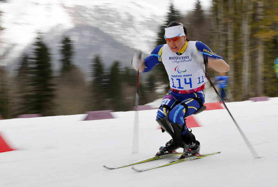 Photo - Lyudmyla Pavlenko of Ukraine races to win the ladies 12km cross country ski, sitting event at the 2014 Winter Paralympic, Sunday, March 9, 2014, in Krasnaya Polyana, Russia. (AP Photo/Dmitry Lovetsky)