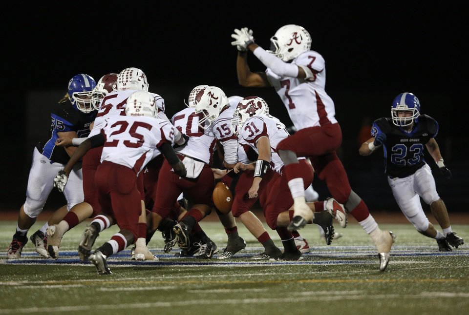 Ardmore fumbles during a high school football game between Deer Creek and Ardmore at Deer Creek Stadium in Edmond, Okla., Friday, Nov. 9, 2012.  Photo by Garett Fisbeck, The Oklahoman