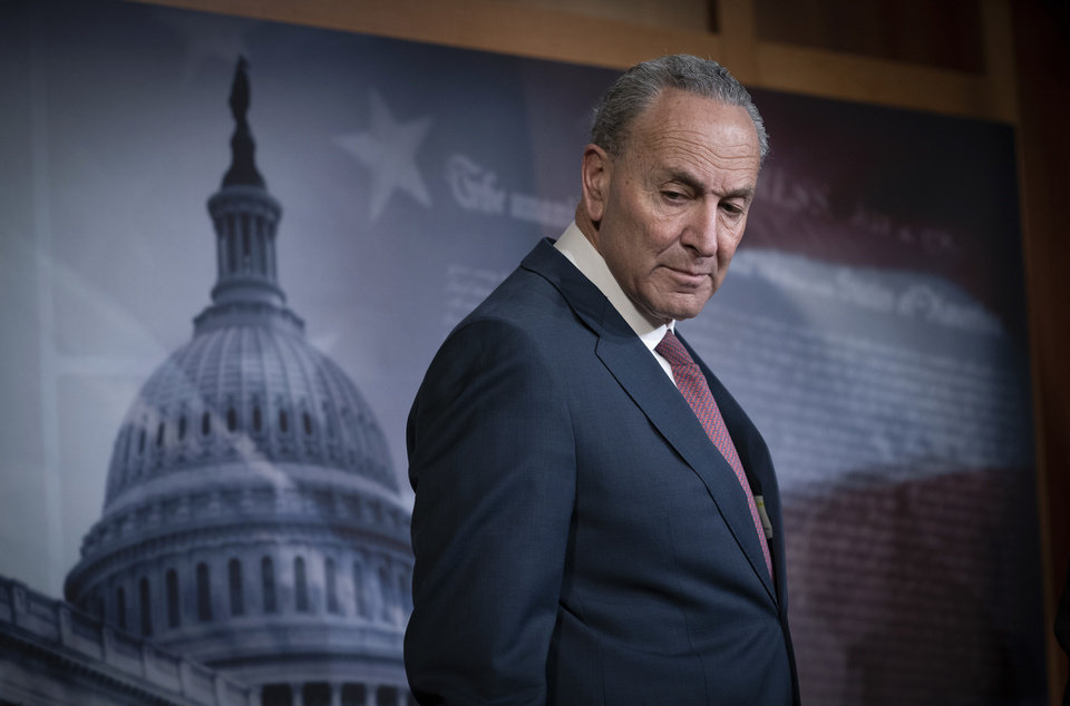 Photo -  Senate Minority Leader Chuck Schumer, D-N.Y., pauses as he speaks to reporters to criticize the process in the Republican-controlled Senate as the impeachment trial of President Donald Trump on charges of abuse of power and obstruction of Congress, resumes in Washington, Friday, Jan. 31, 2020.