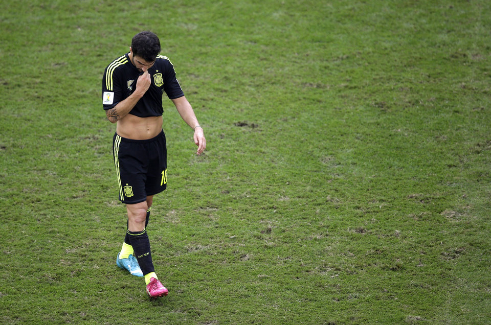 Photo - Spain's Cesc Fabregas leaves the field after the group B World Cup soccer match between Australia and Spain at the Arena da Baixada in Curitiba, Brazil, Monday, June 23, 2014.  Spain won the match 3-0.  (AP Photo/Michael Sohn)