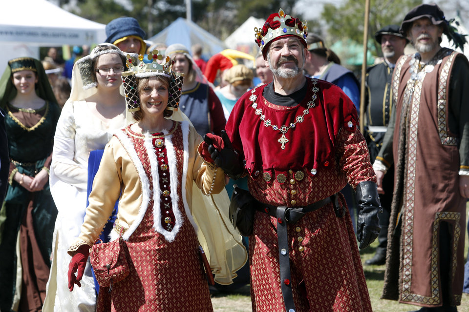Queen Phillipa, Debra Adams, and King Edward III, Cody Clark, take a walk through the park during the Medieval Fair at Reaves Park on Friday, April 5, 2013 in Norman, Okla.  Photo by Steve Sisney, The Oklahoman