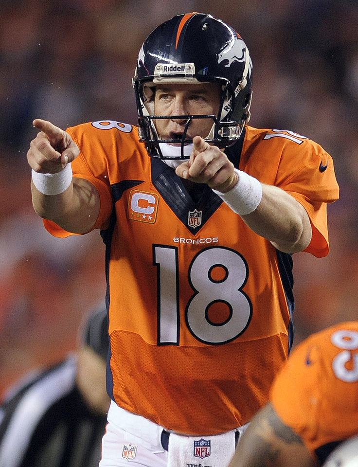 """Photo - FILE - In this Sept. 23, 2013, file photo, Denver Broncos quarterback Peyton Manning (18) calls an audible at the line of scrimmage in the third quarter of an NFL football game against the Oakland Raiders in Denver. The sound of Manning barking """"Omaha! Omaha!"""" is picked up by a tiny microphone in an offensive lineman's pads so it can be broadcast to the world. In an age of enormous high-definition televisions and games streamed to tablets and smartphones, audio seems almost quaint. Yet TV executives have made it a major focus in recent years, for the exact reason so many people are fascinated by the Broncos quarterback's audibles. (AP Photo/Jack Dempsey, File)"""
