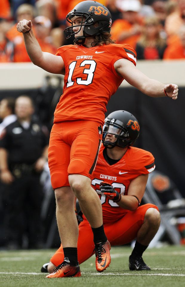 Photo - OSU kicker Quinn Sharp (13) and holder Wes Harlan (39) watch a kick go through the uprights for a field goal in the second quarter during a college football game between Oklahoma State University and the University of Louisiana-Lafayette (ULL) at Boone Pickens Stadium in Stillwater, Okla., Saturday, Sept. 15, 2012. Photo by Nate Billings, The Oklahoman