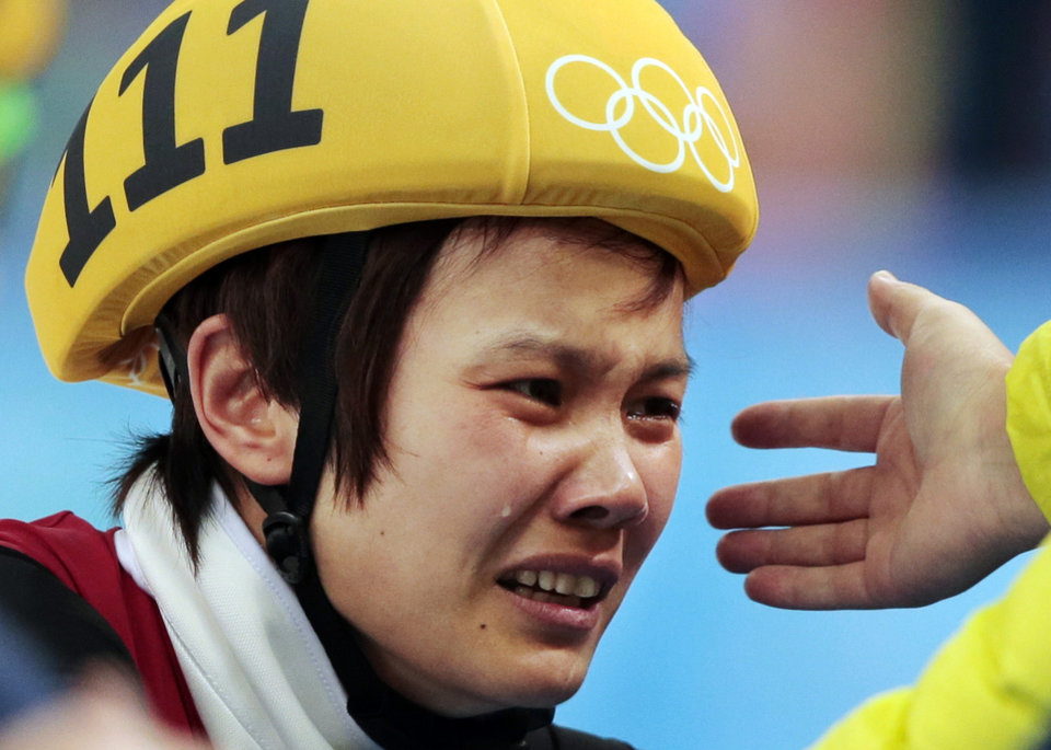 Photo - Li Jianrou of China cries after winning the women's 500m short track speedskating final at the Iceberg Skating Palace during the 2014 Winter Olympics, Thursday, Feb. 13, 2014, in Sochi, Russia. (AP Photo/Ivan Sekretarev, File)