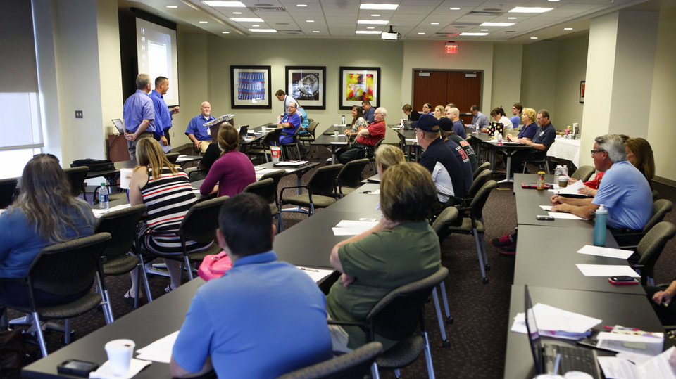 Photo - Shane Cohea, Moore Medical Center emergency preparedness director, tells local hospital representatives about the medical center being hit by the May 20 tornado during a Medical Emergency Response Center meeting at Integris Cancer Institute on Tuesday.  David McDaniel - The Oklahoman