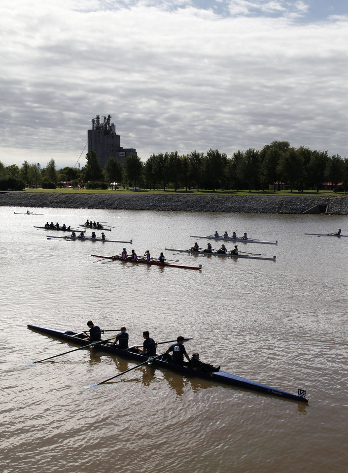 Photo - Rowing teams move toward the staging area during the Oklahoma Regatta Festival on the Oklahoma River in Oklahoma City, OK, Saturday, October 5, 2013,  Photo by Paul Hellstern, The Oklahoman