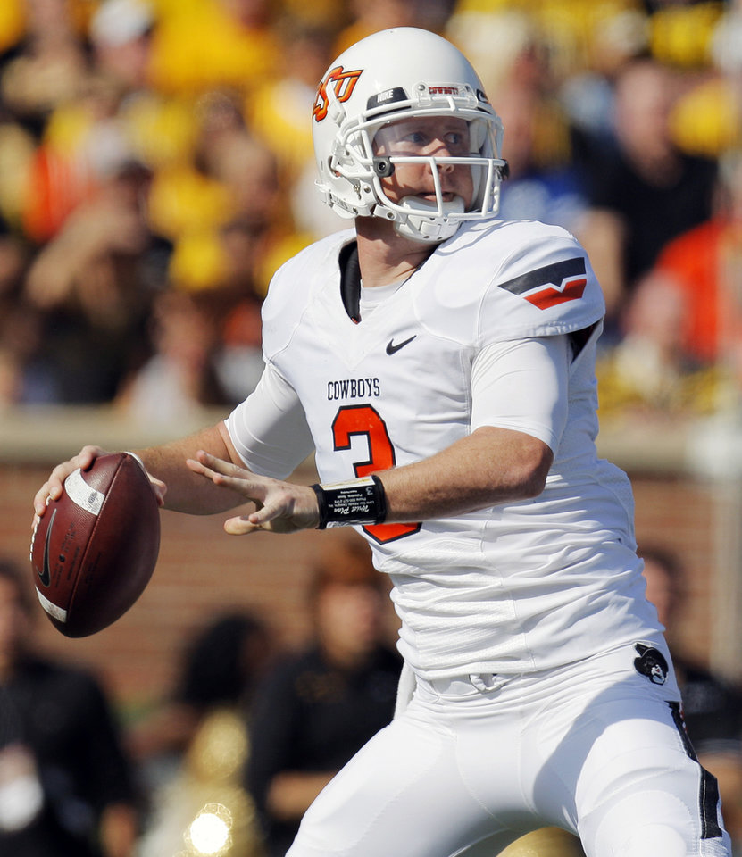 Oklahoma State's Brandon Weeden (3) passes the ball during a college football game between the Oklahoma State University Cowboys (OSU) and the University of Missouri Tigers (Mizzou) at Faurot Field in Columbia, Mo., Saturday, Oct. 22, 2011. Photo by Nate Billings, The Oklahoman