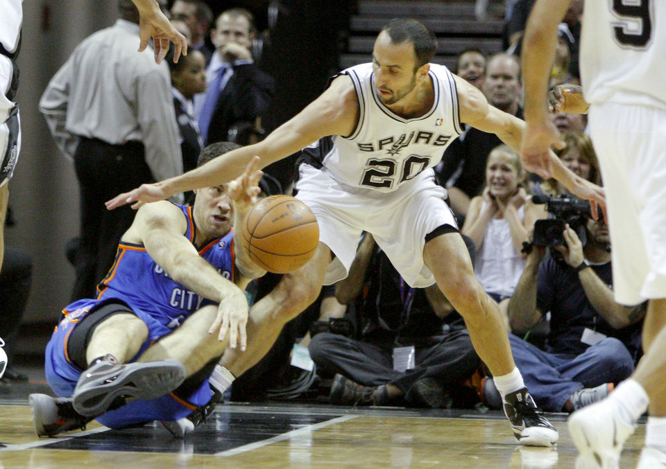 Oklahoma City\'s Nick Collison (4) passes the ball around San Antonio\'s Manu Ginobili (20) during Game 1 of the Western Conference Finals between the Oklahoma City Thunder and the San Antonio Spurs in the NBA playoffs at the AT&T Center in San Antonio, Texas, Sunday, May 27, 2012. Photo by Bryan Terry, The Oklahoman