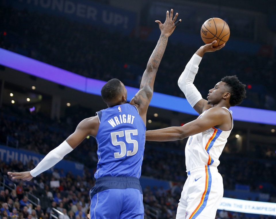 Photo - Oklahoma City's Hamidou Diallo (6) shoots over Delon Wright (55) of Dallas during an NBA basketball game between the Oklahoma City Thunder and the Dallas Mavericks at Chesapeake Energy Arena in Oklahoma City, Tuesday, Dec. 31, 2019. Oklahoma City won 106-101. [Bryan Terry/The Oklahoman]