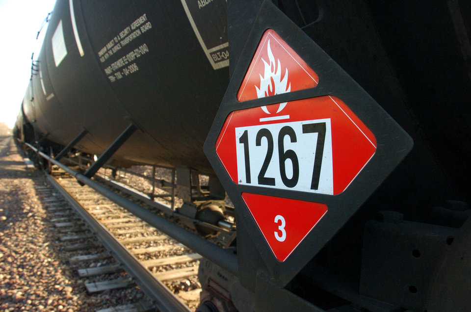 A warning placard on a tank car carrying crude oil is seen on a train idled on the tracks near a crude loading terminal Nov. 6 in Trenton, N.D. The transport of oil by rail has expanded more than thirty-fold since 2009, delivering higher prices for oil companies able to access coastal refineries but also raising concerns about spills. AP Photo Matthew Brown