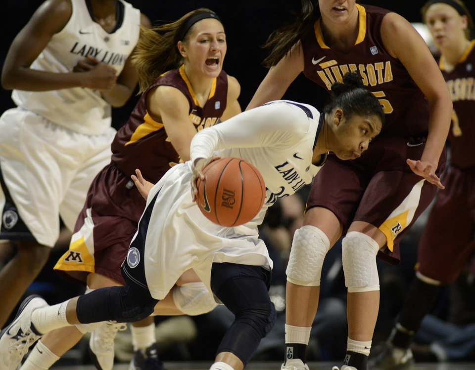 Penn State's Alex Bentley, center, looks for a way around Minnesota's Shayne Mullaney, left, and Katie Loberg during the second half of an NCAA college basketball game in State College, Pa., Thursday, Jan. 24, 2013. Penn State won 64-59. (AP Photo/Ralph Wilson)