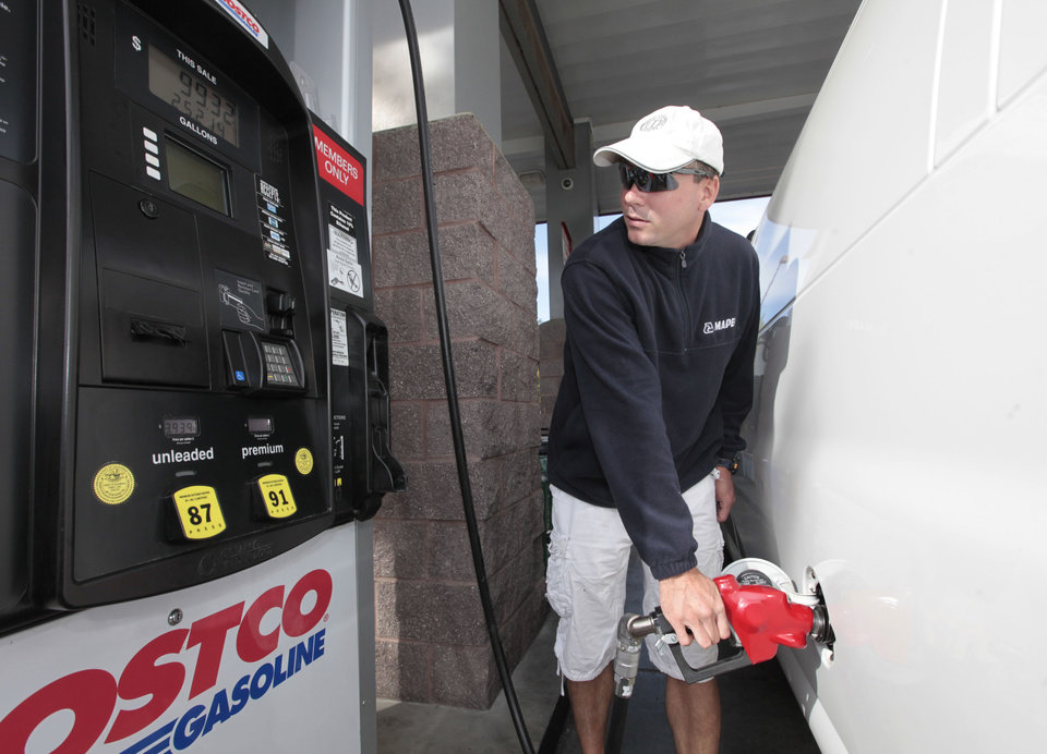 Michael Dytrych fuels up at the Costco gas station in Sacramento, Calif., Friday, Oct. 5, 2012. Californians woke up to a shock Friday as overnight gasoline prices jumped by as much as 20 cents a gallon in some areas, ending a week of soaring costs that saw some stations close and others charge record prices. The average price of regular gas across the state was nearly $4.49 a gallon, the highest in the nation, according to AAA's Daily Fuel Gauge report. (AP Photo/Rich Pedroncelli)