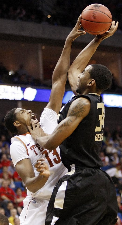 Photo - Tristan Thompson (13) of Texas blocks the shot of Keith Benson (34) of Oakland in the first half during the NCAA men's basketball tournament second round game between Oakland and Texas at the BOK Center in Tulsa, Okla., Friday, March 18, 2011.  Photo by Nate Billings, The Oklahoman