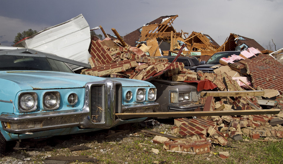 A tornado left a path of destruction as it passed through Friday, March 2, 2012, in Athens, Ala. Powerful storms stretching from the Gulf Coast to the Great Lakes flattened buildings in several states, wrecked two Indiana towns and bred anxiety across a wide swath of the country in the second powerful tornado outbreak this week.  (AP Photo/Butch Dill) ORG XMIT: ALBD116