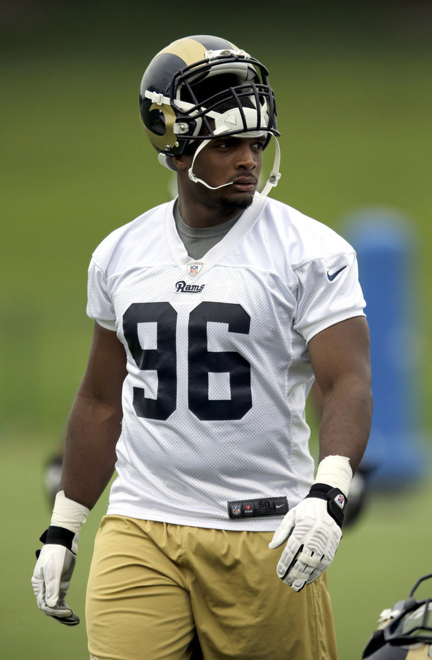 Photo - St. Louis Rams rookie defensive end Michael Sam takes part in an organized team activity at the NFL football team's practice facility Thursday, June 5, 2014, in St. Louis. (AP Photo/Jeff Roberson)