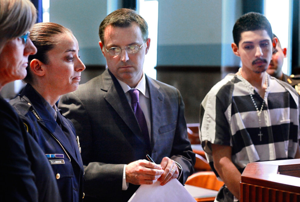 Officer Katie Lawson, second from left, makes a statement to the court during the sentencing of Hector Escalante, far right.  Brothers Alex Mercado and Hector Escalante were given separate sentences by District Judge Donald Deason in an Oklahoma County courtroom Tuesday afternoon, Nov. 8, 2011 for  their involvement in shooting Oklahoma City police officer Katie Lawson during an ambush in south Oklahoma City in Aug, 2010.   Chief Bill Citty and his four assistant chiefs were seated among  nearly 40 uniformed police officers in the courtroom as the sentences were imposed. Several said they came to support Officer Lawson.  Photo by Jim Beckel, The Oklahoman