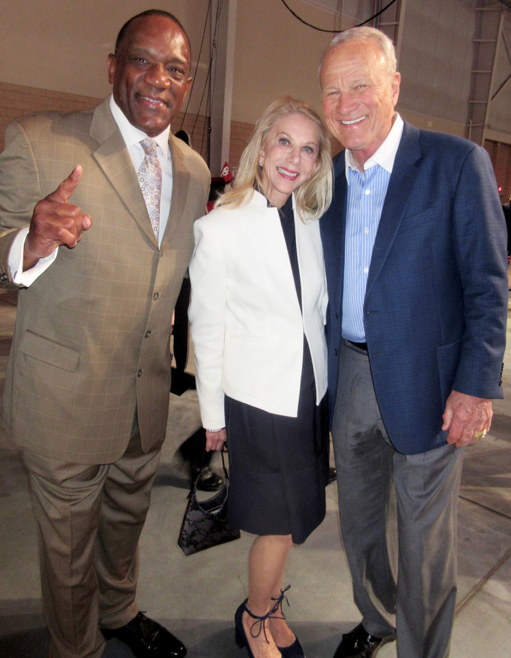 Photo - Billy Sims, Becky and Barry Switzer. PHOTO BY HELEN FORD WALLACE, THE OKLAHOMAN