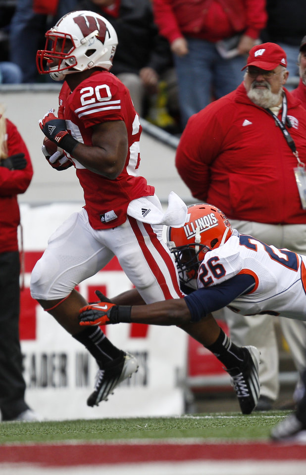 Wisconsin running back James White (20) runs for a 62-yard touchdown against Illinois defensive back Justin Green during the first half of an NCAA college football game on Saturday, Oct. 6, 2012, in Madison, Wis. (AP Photo/Andy Manis)