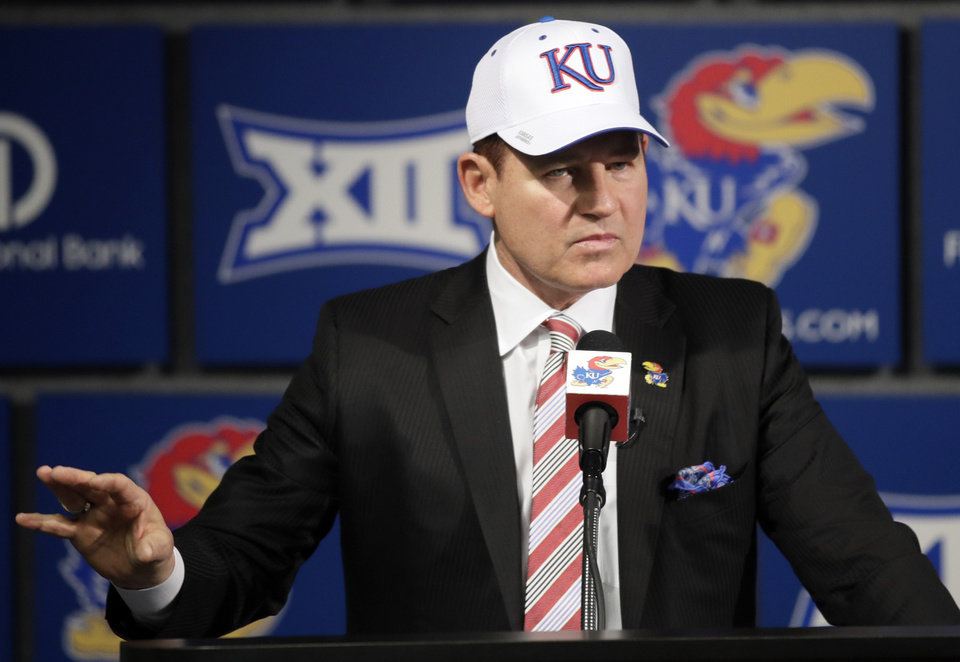 Photo - University of Kansas new football coach Les Miles makes a statement during a news conference in Lawrence, Kan., Sunday, Nov. 18, 2018. (AP Photo/Orlin Wagner)