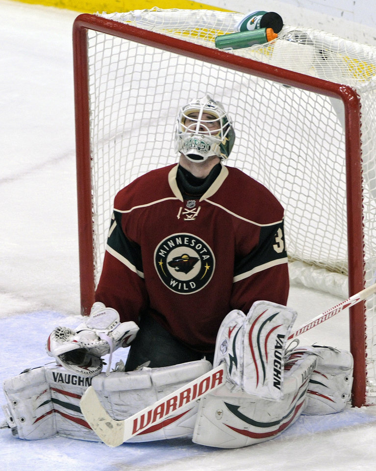 FILE - This Jan. 31, 2012 file photo shows Minnesota Wild goalie Josh Harding reacting after giving up a goal to the Nashville Predators in the third period of an NHL game in St. Paul, Minn.  (AP Photo/Jim Mone, File)