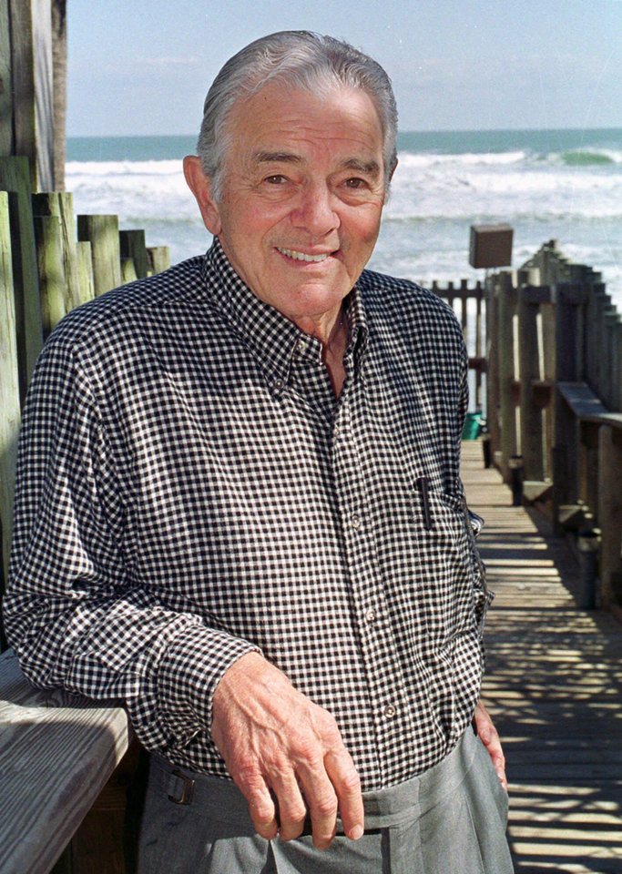 Photo - FILE - In this Dec.1999 file photo, Al Neuharth, founder of USA Today, poses at his home in Cocoa Beach, Fla.  USA Today founder Al Neuharth has died in Cocoa Beach, Fla. He was 89. The news was announced Friday, April 19, 2013 by USA Today and by the Newseum, which he also founded. (AP Photo/Peter Cosgrove, File)