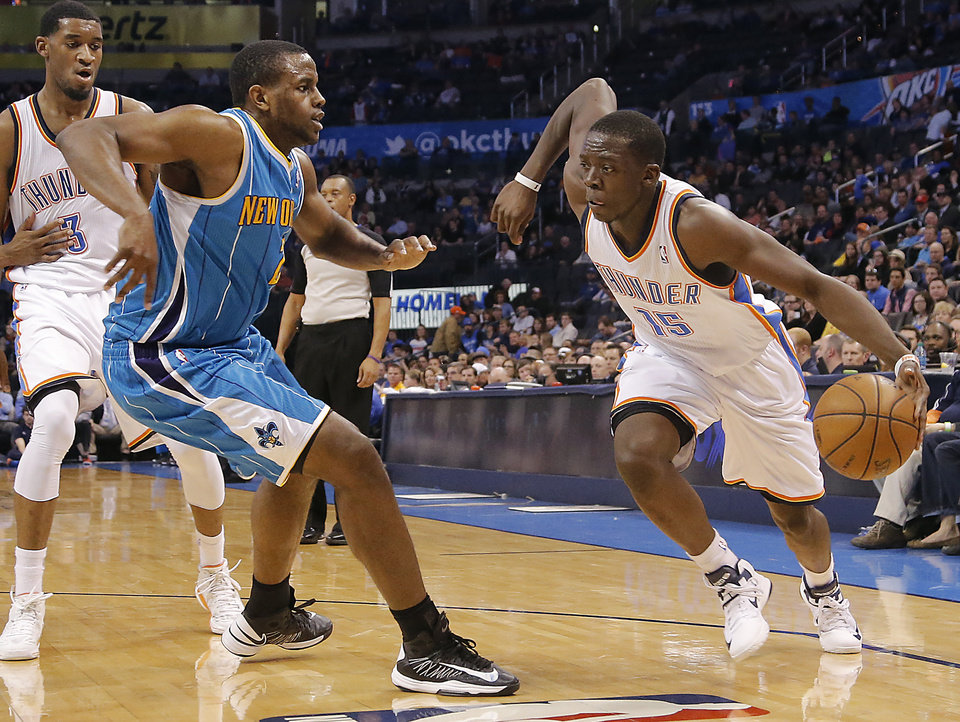 Photo - Oklahoma City Thunder's Reggie Jackson (15) drives past New Orleans Hornets' Darius Miller (2) during the NBA basketball game between the Oklahoma City Thunder and the New Orleans Hornets at the Chesapeake Energy Arena on Wednesday, Feb. 27, 2013, in Oklahoma City, Okla. Photo by Chris Landsberger, The Oklahoman