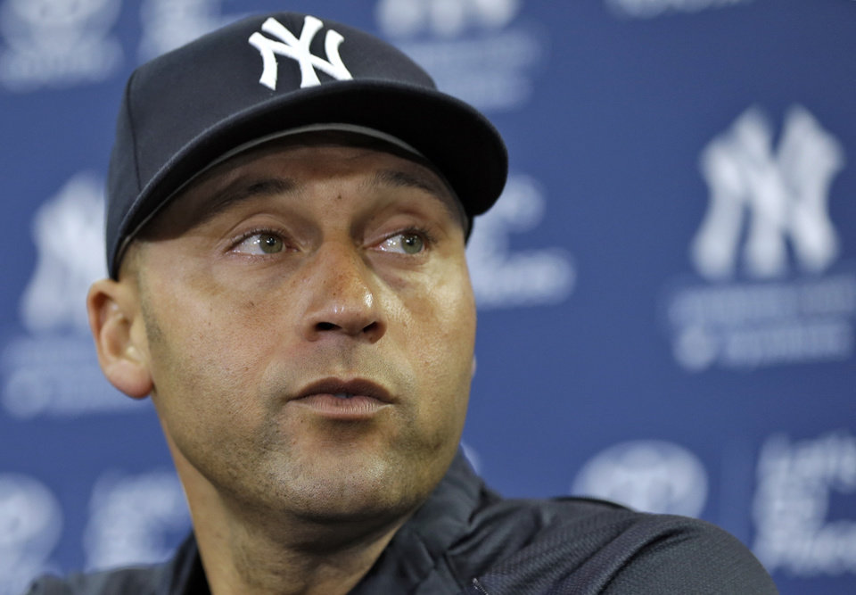 Photo - New York Yankees shortstop Derek Jeter listens to a question during a news conference Wednesday, Feb. 19, 2014, in Tampa, Fla. Jeter has announced he will retire at the end of the 2014 season. (AP Photo/Chris O'Meara)