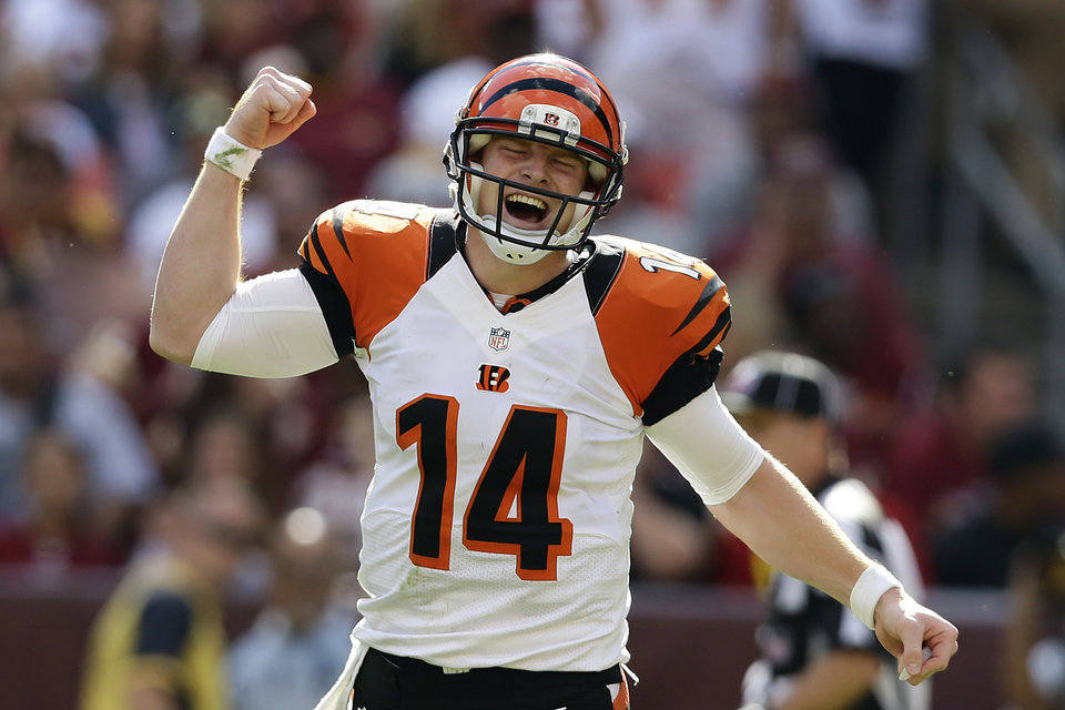 Photo -   Cincinnati Bengals quarterback Andy Dalton reacts to a touchdown pass to wide receiver Andrew Hawkins during the second half of an NFL football game against the Washington Redskins in Landover, Md., Sunday, Sept. 23, 2012. The Bengals defeated the Redskins 38 - 31.(AP Photo/Alex Brandon)