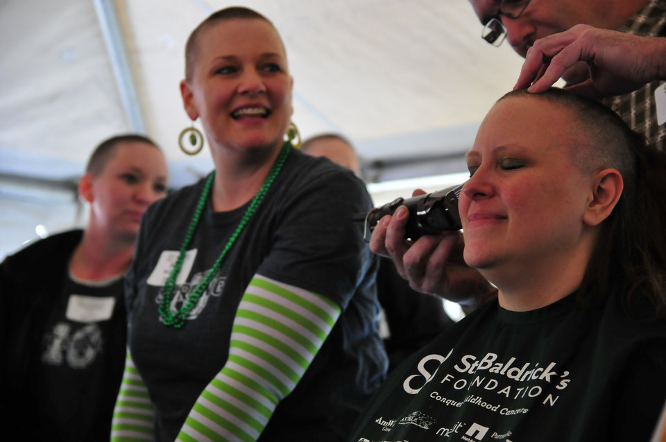 Jessica Maynard, a member of the 10 Strong team, gets her head shaved for the St. Baldrick's charity at VZD's Restaurant and Club in Oklahoma City, Okla. Sunday, March 23, 2013.  Photo by Nick Oxford, for The Oklahoman