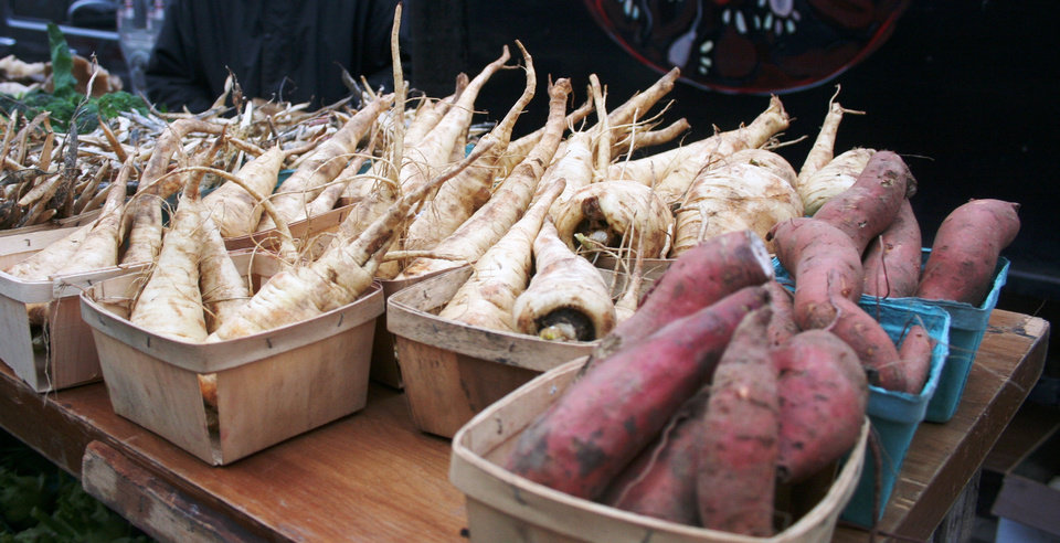 Photo - Root vegetables are in large supply at the Ann Arbor Farmer's Market.  DAVE CATHEY - THE OKLAHOMAN