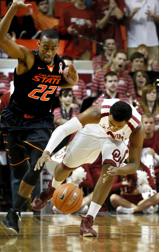 Sooner\'s Steven Pledger (2) tries to handle the inbounds pass guarded by Cowboy\'s Markel Brown (22) during the second half as the University of Oklahoma Sooners (OU) defeat the Oklahoma State Cowboys (OSU) 77-68 in NCAA, men\'s college basketball at The Lloyd Noble Center on Saturday, Jan. 12, 2013 in Norman, Okla. Photo by Steve Sisney, The Oklahoman
