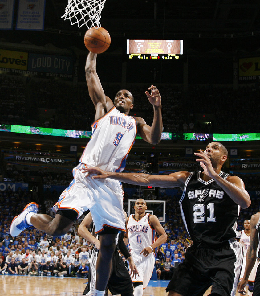 Oklahoma City\'s Serge Ibaka (9) dunks against San Antonio\'s Tim Duncan (21) in the second half during Game 4 of the Western Conference Finals between the Oklahoma City Thunder and the San Antonio Spurs in the NBA playoffs at the Chesapeake Energy Arena in Oklahoma City, Saturday, June 2, 2012. Oklahoma City won, 109-103. Photo by Nate Billings, The Oklahoman