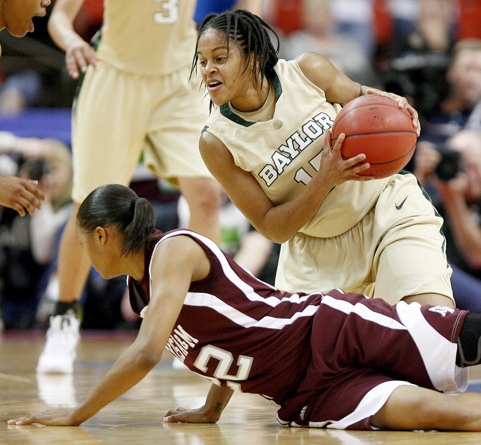 Photo - Baylor's Jhasmin Player grabs the ball over Texas A&M's Tanisha Smith during the championship game of the Big 12 Women's Basketball Championship between Baylor and Texas A&M at the Cox center in Oklahoma City, Sunday, March 15, 2009. PHOTO BY BRYAN TERRY, THE OKLAHOMAN