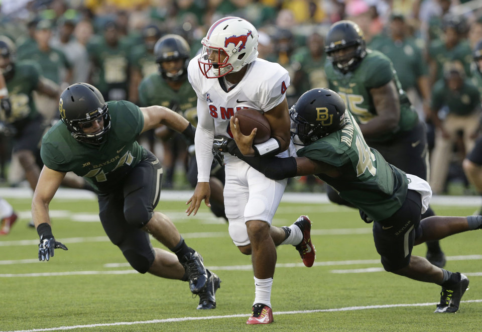 Photo - SMU quarterback Matt Davis (4) is pressured by Baylor safety Travon Blanchard (48) and linebacker Bryce Hager (44) during the first half of an NCAA college football game Sunday, Aug. 31, 2014, in Waco, Texas. (AP Photo/LM Otero)