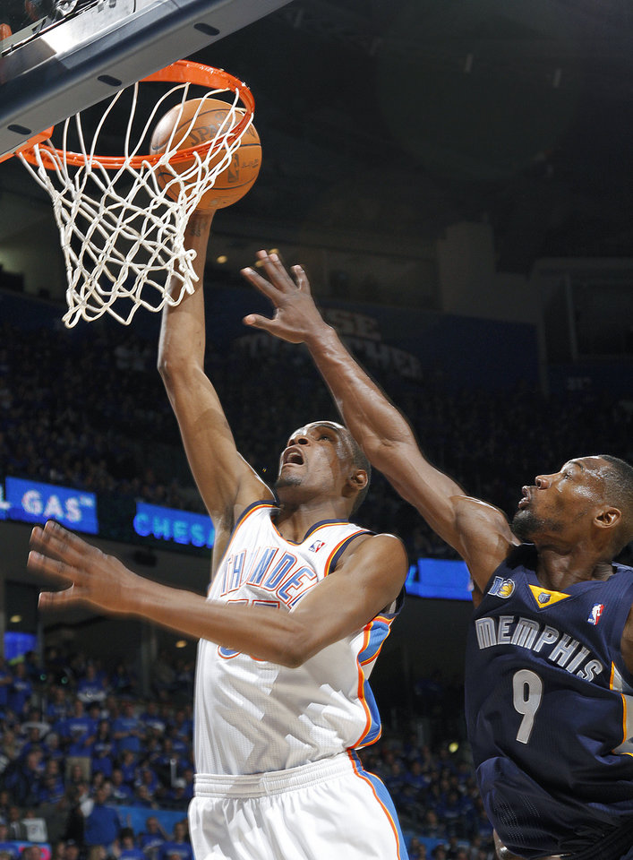 Photo - Oklahoma City's Kevin Durant (35) drives past Memphis' Tony Allen (9) during game one of the Western Conference semifinals between the Memphis Grizzlies and the Oklahoma City Thunder in the NBA basketball playoffs at Oklahoma City Arena in Oklahoma City, Sunday, May 1, 2011. Photo by Chris Landsberger, The Oklahoman