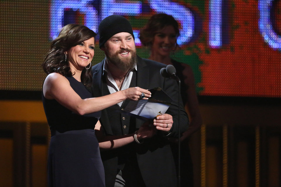 Photo - Martina McBride, left, and Zac Brown present the award for best country album at the 56th annual Grammy Awards at Staples Center on Sunday, Jan. 26, 2014, in Los Angeles. (Photo by Matt Sayles/Invision/AP)