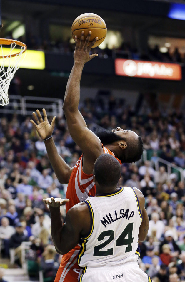 Houston Rockets' James Harden, rear, shoots as Utah Jazz's Paul Millsap (24) defends during the second quarter of an NBA basketball game, Monday, Jan. 28, 2013, in Salt Lake City. (AP Photo/Rick Bowmer)