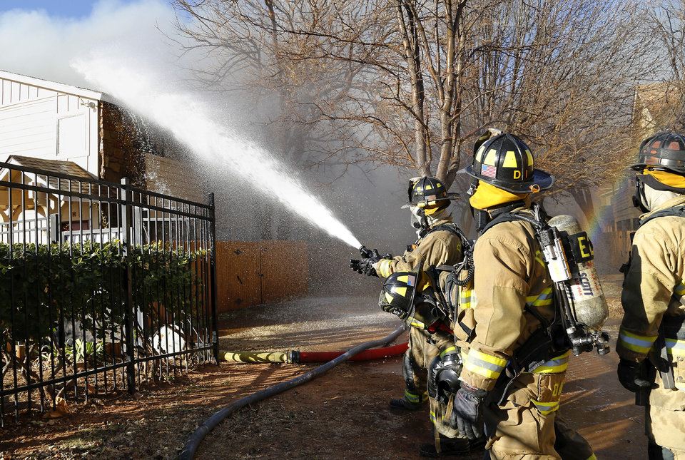 Oklahoma City firefighters battled a four-alarm blaze for more than an hour at Quail Springs Condominiums, 14415 N Pennsylvania, before extinguishing most of the flames.  Around 3 p.m. on Tuesday, Dec. 31, 2013,  fire units were dispatched to the complex, just north of Memorial Road.  A chief at the scene said high winds presented additional problems for firefighters as they worked to keep the fire from spreading to other units.  Photo by Jim Beckel, The Oklahoman