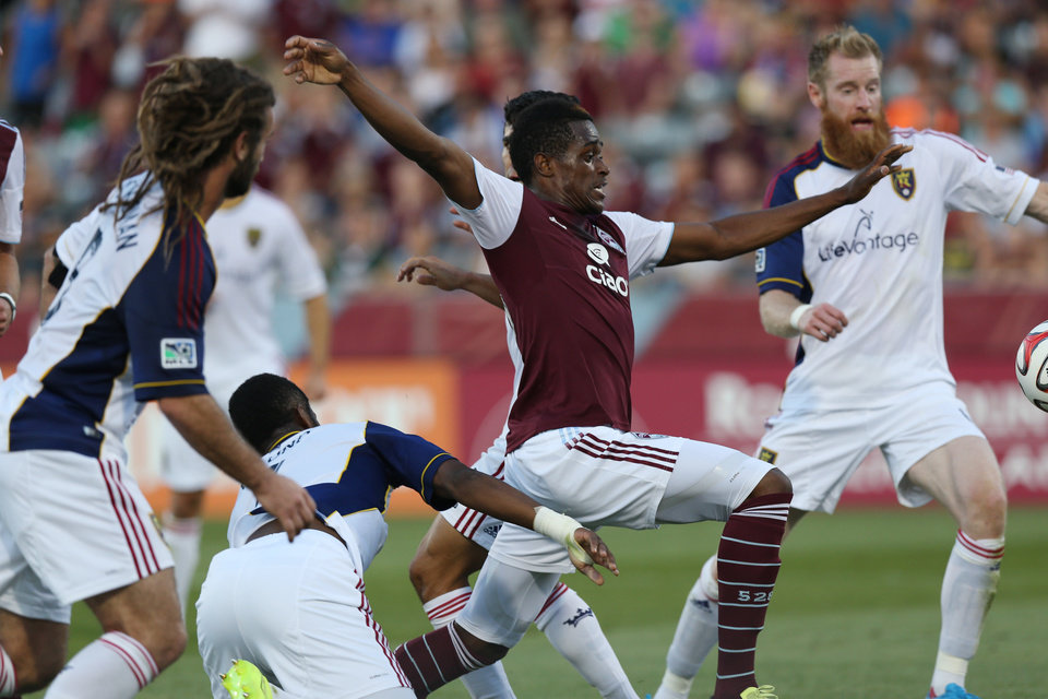 Photo - Colorado Rapids forward Deshorn Brown, second from right, tries to kick ball in for goal as, from left, Real Salt Lake's Kyle Beckerman, Aaron Maund and Nat Borchers defend during the first half of an MLS soccer game in Commerce City, Colo., on Saturday, Aug. 2, 2014. (AP Photo/David Zalubowski)