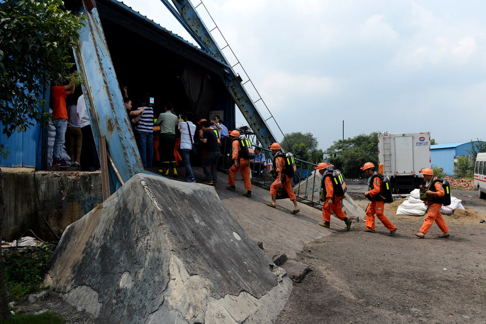Photo - In this Aug. 19, 2014 photo, rescuers prepare to go into the Dongfang Coal Mine in Xiejiaji District of Huainan City, east China's Anhui Province, Tuesday, Aug. 19, 2014.  An explosion Tuesday in the coal mine in eastern China trapped 27 workers underground, state media reported. (AP Photo/Xinhua, Zhang Duan) NO SALES